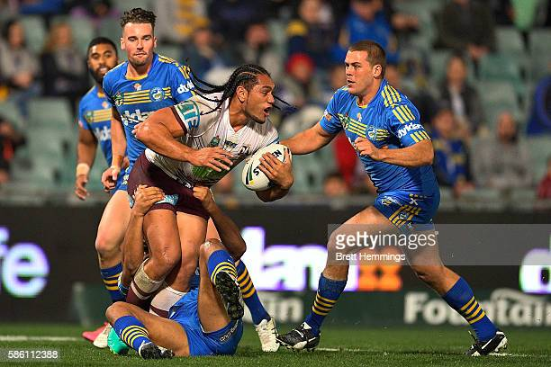 Joshua Starling of Manly looks to pass the ball during the round 22 NRL match between the Parramatta Eels and the Manly Sea Eagles at Pirtek Stadium...