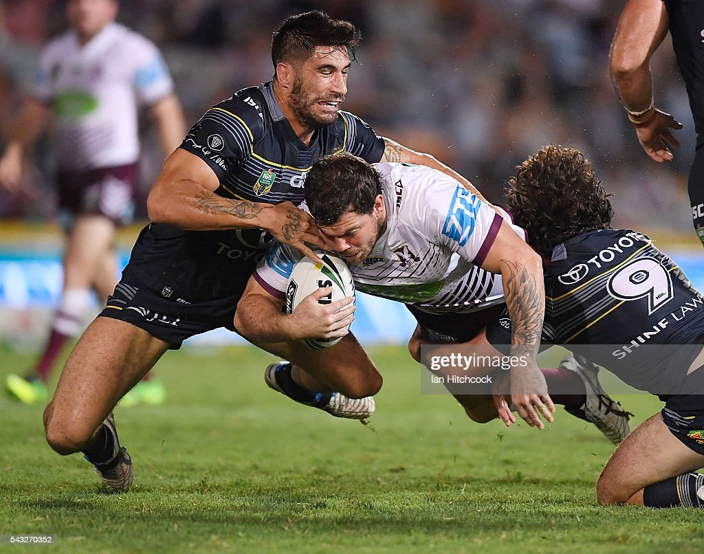 Joshua Starling of the Sea Eagles is tackled by James Tamou and Jake Granville of the Cowboys during the round 16 NRL match between the North Queensland Cowboys and the Manly Sea Eagles at 1300SMILES Stadium on June 27, 2016 in Townsville, Australia.