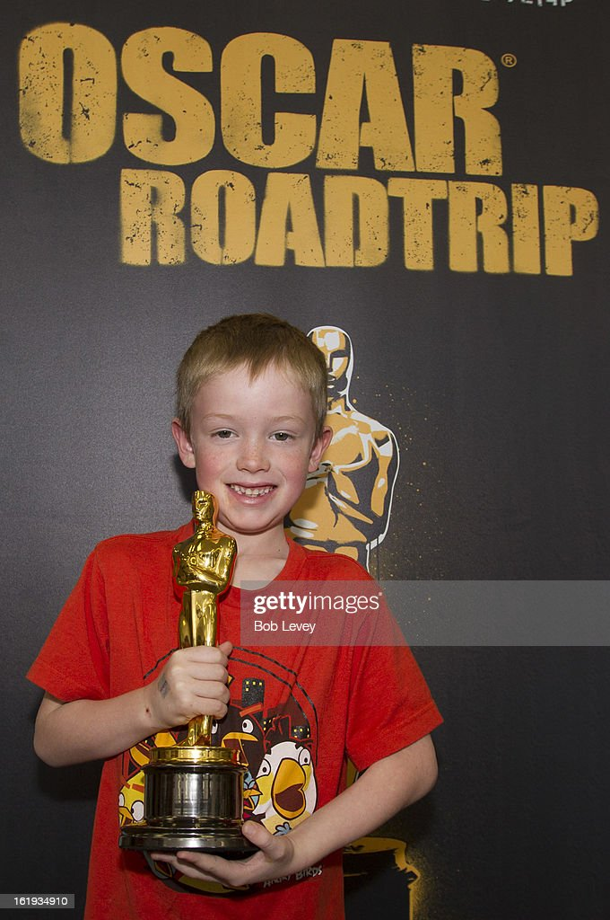 Joshua Swartz of Austin, holds the Oscar statue during the First-Ever Oscar Roadtrip on February 17, 2013 in Houston, Texas.