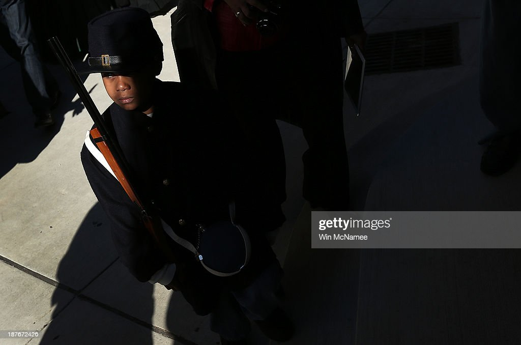 Joshua Terry, dressed in a Civil War era military uniform, enters the African American Civil War Museum after participating in a wreath-laying ceremony commemorating Veterans Day and honoring the Tuskegee Airmen November 11, 2013 in Washington, DC. The ceremony was held at the African American Civil War Memorial on the day that World War I ended 95 years ago, the date the United States honors all of its military veterans.