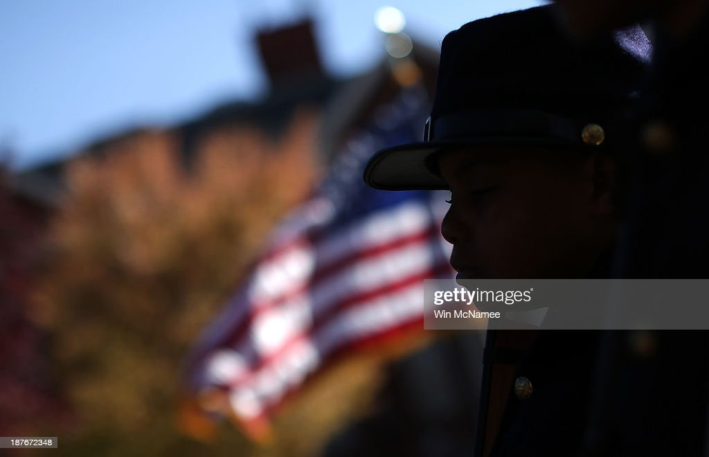 Joshua Terry, dressed in a Civil War military uniform, participates in a wreath-laying ceremony commemorating Veterans Day and honoring the Tuskegee Airmen November 11, 2013 in Washington, DC. The ceremony was held at the African American Civil War Memorial on the day that World War I ended 95 years ago, the date the United States honors all of its military veterans.
