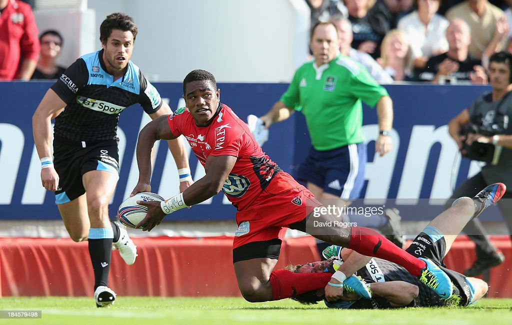 Joshua Tuisova of Toulon passes the ball during the Heineken Cup Pool 2 match between Toulon and Glasgow Warriors at the Felix Mayol Stadium on October 13, 2013 in Toulon, France.