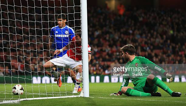 Joshua Vickers of Arsenal looks on after Charlie Colkett of Chelsea's shot deflects off him to score a goal during the FA Youth Cup Semi Final Second...