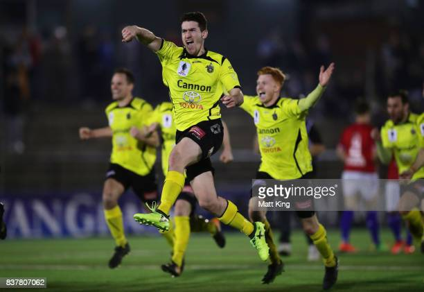 Joshua Wilkins of Heidleberg United and team mates celebrate victory after the penalty shoot out during the FFA Cup round of 16 match between Sydney...