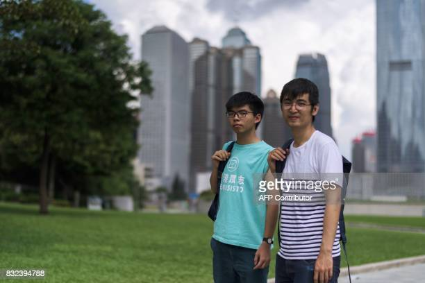 Joshua Wong and Alex Chow leaders of Hong Kong's 'Umbrella Movement' pose after an interview with AFP in Hong Kong on August 16 2017 A defiant Joshua...