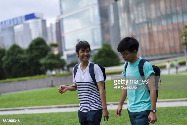 Joshua Wong and Alex Chow leaders of Hong Kong's 'Umbrella Movement' talk before an interview with AFP in Hong Kong on August 16 2017 A defiant...