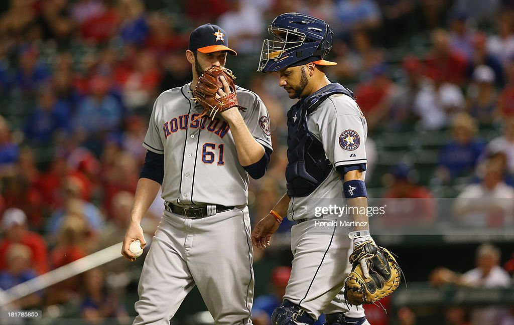 Joshua Zeid #61 and Carlos Corporan #22 of the Houston Astros at Rangers Ballpark in Arlington on September 24, 2013 in Arlington, Texas.