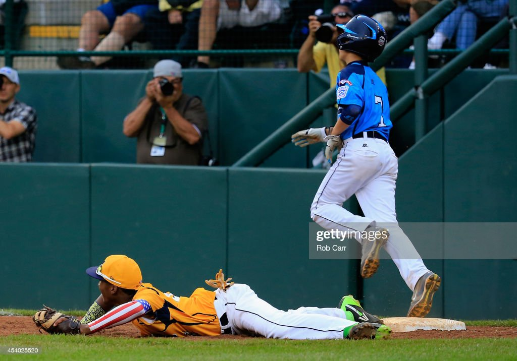 Josiah Cromwick #7 of the West Team from Las Vegas, Nevada is forced out by first baseman Trey Hondras #24 of the Great Lakes Team from Chicago, Illinois for the final out of the game during the United States Championship game of the Little League World Series at Lamade Stadium on August 23, 2014 in South Williamsport, Pennsylvania. Great Lakes won 7-5.