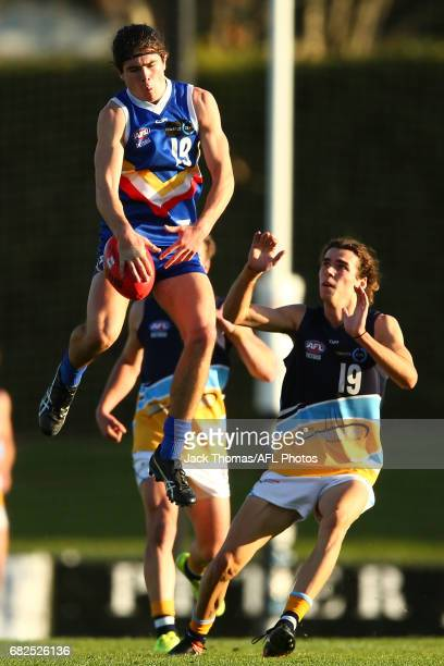Josiah Duncan of the Ranges attempts to mark the ball during the round seven TAC Cup match between the Eastern Ranges and the Bendigo Pioneers at Box...