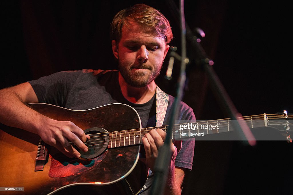Josiah Johnson of Head and the Heart performs on stage at Columbia City Theater on October 14, 2013 in Seattle, Washington.
