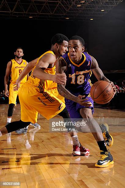 Josiah Turner of the Los Angeles DFenders drives to the basket against Chris Crawford of the Canton Charge at the Canton Memorial Civic Center on...