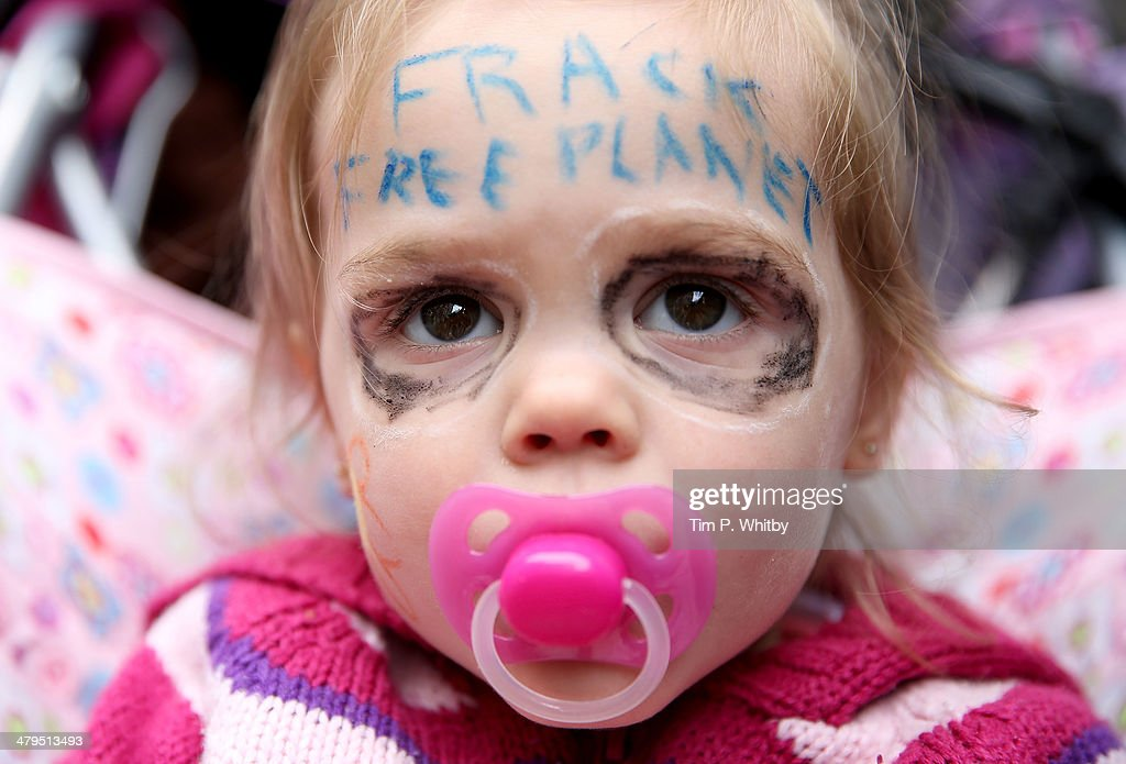 Josie, 2 from Southend who was joined by her parents attending a protest march at the Fracked Future Carnival on March 19, 2014 in London, England.