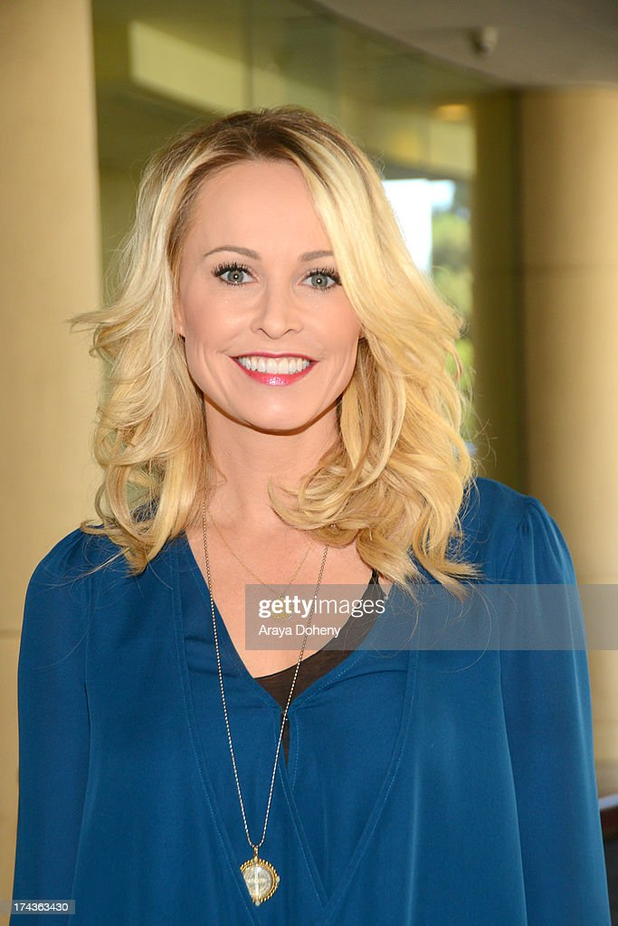 <a gi-track='captionPersonalityLinkClicked' href=/galleries/search?phrase=Josie+Bissett&family=editorial&specificpeople=1503025 ng-click='$event.stopPropagation()'>Josie Bissett</a> arrives at the Television Critic Association's Summer press tour - Hallmark Channel & Hallmark Movie Channel party at The Beverly Hilton Hotel on July 24, 2013 in Beverly Hills, California.