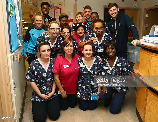 Josie Green Josh Onomah Christian Eriksen and Ben Davies of Tottenham Hotspur deliver Christmas presents to Children at Barnet Hospital on December...