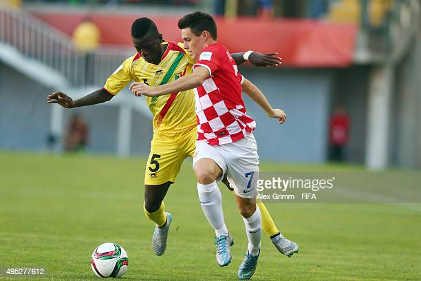 Josip Brekalo of Croatia is challenged by Mamadou Sangare of Mali during the FIFA U17 World Cup Chile 2015 Quarter Final match between Croatia and...