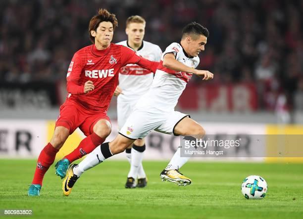 Josip Brekalo of VfB Stuttgart is tackled by Yuya Osako of 1FC Koeln during the Bundesliga match between VfB Stuttgart and 1 FC Koeln at MercedesBenz...