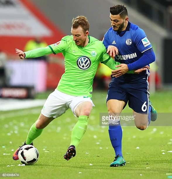 Josip Brekalo of VfL Wolfsburg is challenged by Sead Kolasinac of Schalke 04 during the Bundesliga match between VfL Wolfsburg and FC Schalke 04 at...