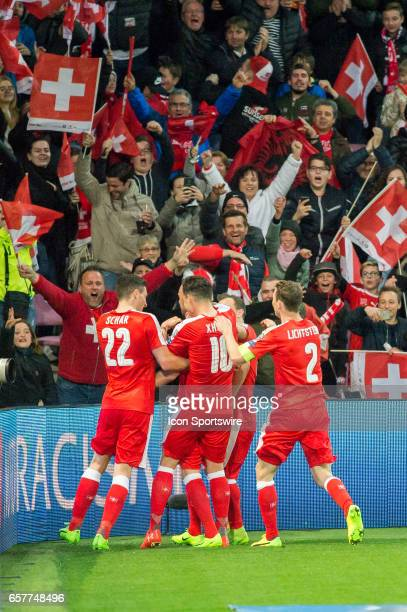 Josip Drmic celebrates first goal with team mates during the World Cup Qualifiers group match between Switzerland and Latvia on March 25 at Stade de...