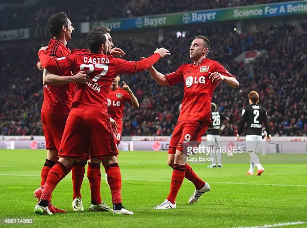 Josip Drmic of Bayer 04 Leverkusen is congratulated after scoring the second goal during the Bundesliga match between Bayer 04 Leverkusen and VfB...