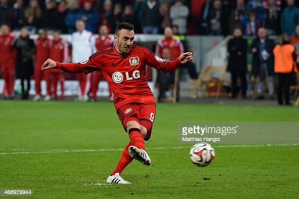 Josip Drmic of Bayer Leverkusen takes a penalty during the DFB Cup Quarter Final match between Bayer Leverkusen and FC Bayern Muenchen at BayArena on...