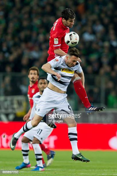 Josip Drmic of Borussia Moenchengladbach and Javi Martinez of Bayern Muenchen battle for the ball during the Bundesliga match between Borussia...