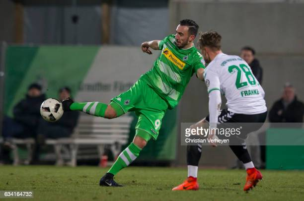 Josip Drmic of Borussia Moenchengladbach and Marcel Franke of SpVgg Greuther Fuerth battle for the ball during the DFB Cup match between SpVgg...