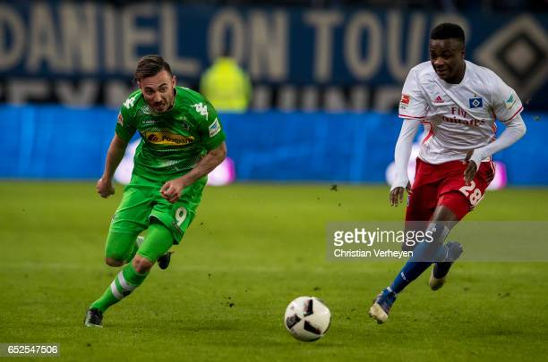 Josip Drmic of Borussia Moenchengladbach is chased by Gideon Jung of Hamburger SV during the Bundesliga match between Hamburger SV and Borussia...