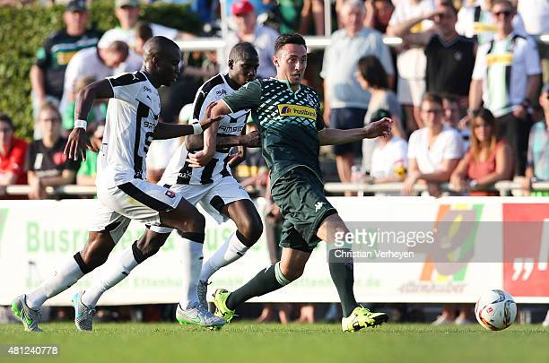 Josip Drmic of Borussia Moenchengladbach is chased by Yacouba Sylla of Stade Rennes during the friendly match between Stade Rennes and Borussia...