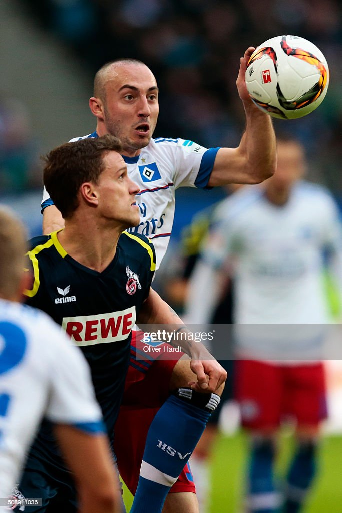 Josip Drmic (R) of Hamburg and Simon Zoller (R) of Koeln compete for the ball during the First Bundesliga match between Hamburger SV and 1. FC Koeln at Volksparkstadion on February 7, 2016 in Hamburg, Germany.