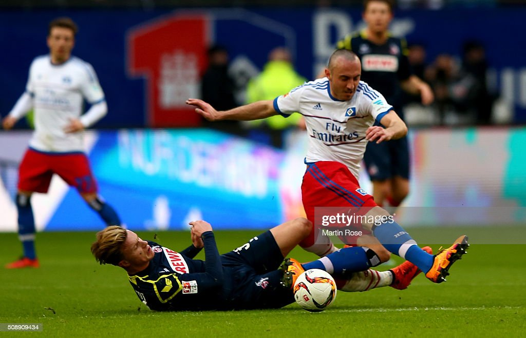 Josip Drmic #18 of Hamburg and Yannick Gerhardt of Koeln battle for the ball during the Bundesliga match between Hamburger SV and 1. FC Koeln at Volksparkstadion on February 7, 2016 in Hamburg, Germany.