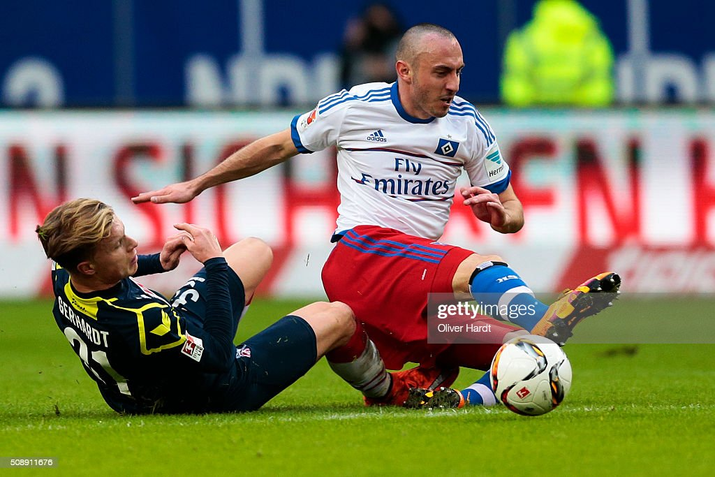 Josip Drmic (R) of Hamburg and Yannick Gerhardt (L) of Koeln compete for the ball during the First Bundesliga match between Hamburger SV and 1. FC Koeln at Volksparkstadion on February 7, 2016 in Hamburg, Germany.