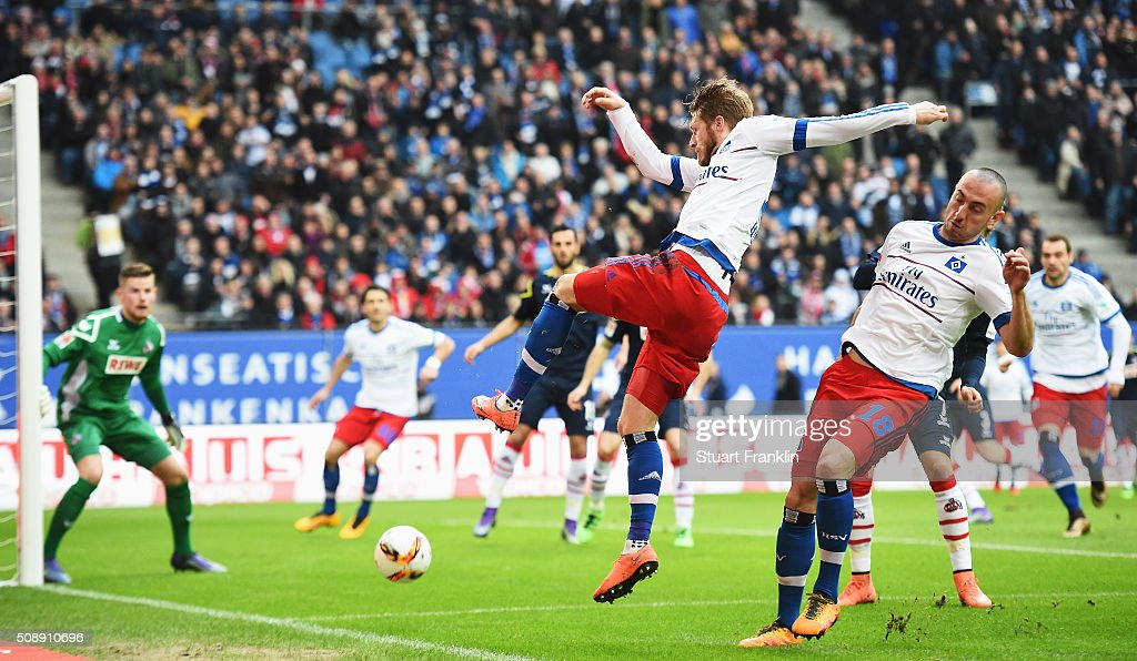 Josip Drmic of Hamburg is challenged by <a gi-track='captionPersonalityLinkClicked' href=/galleries/search?phrase=Aaron+Hunt+-+Soccer+Player&family=editorial&specificpeople=4224372 ng-click='$event.stopPropagation()'>Aaron Hunt</a> of Hamburg during the Bundesliga match between Hamburger SV and 1. FC Koeln at Volksparkstadion on February 7, 2016 in Hamburg, Germany.