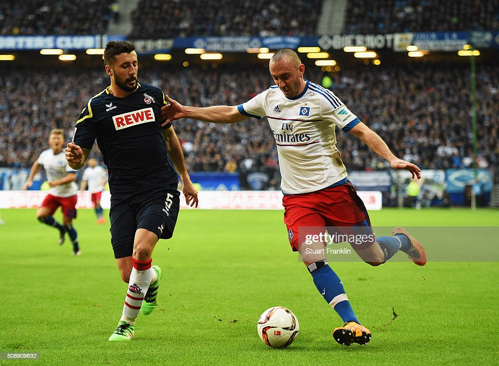 Josip Drmic of Hamburg is challenged by <a gi-track='captionPersonalityLinkClicked' href=/galleries/search?phrase=Dominic+Maroh&family=editorial&specificpeople=5633010 ng-click='$event.stopPropagation()'>Dominic Maroh</a> of Cologne during the Bundesliga match between Hamburger SV and 1. FC Koeln at Volksparkstadion on February 7, 2016 in Hamburg, Germany.