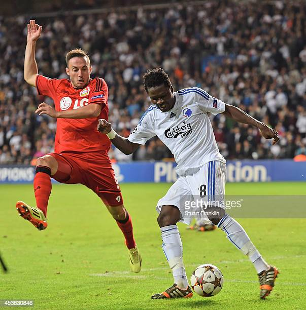 Josip Drmic of Leverkusen is challenged by Daniel Amartey of Copenhagen during the first leg of the UEFA Champions league qualifying playoff match...