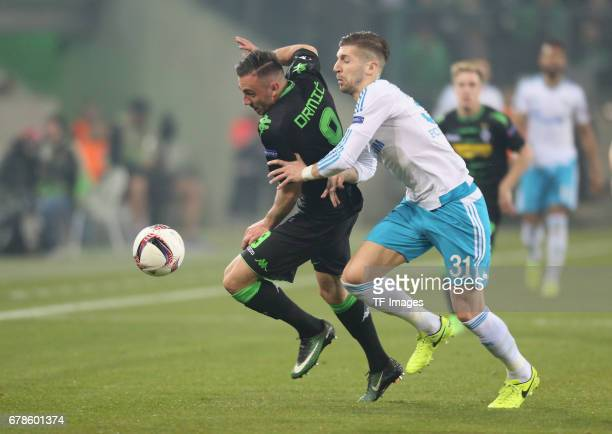 Josip Drmic of Moenchengladbach and Matija Nastasic of Schalke battle for the ball during the UEFA Europa League Round of 16 second leg match between...