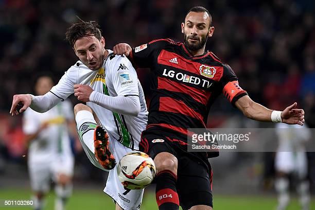 Josip Drmic of Moenchengladbach and Oemer Toprak of Leverkusen battle for the ball during the Bundesliga match between Bayer Leverkusen and Borussia...