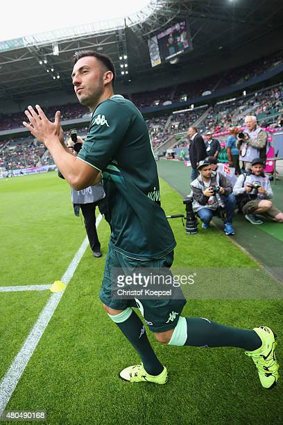 Josip Drmic of Moenchengladbach welcomes the audience prior to the Telekom Cup 2015 Semi Final match between Borussia Moenchegladbach and Hamburger...