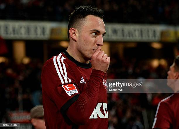 Josip Drmic of Nuernberg celebrates after scoring his team's second goal during the Bundesliga match between 1 FC Nuernberg and VfB Stuttgart at...