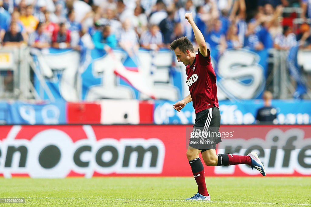 Josip Drmic of Nuernberg celebrates his team's first goal during the Bundesliga match between 1. FC Nuernberg and Hertha BSC Berlin at Grundig Stadium on August 18, 2013 in Nuremberg, Germany.