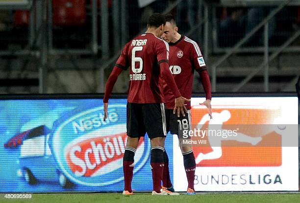 Josip Drmic of Nuernberg celebrates the opening goal with team mate Martin Angha during the Bundesliga match between 1 FC Nuernberg and VfB Stuttgart...