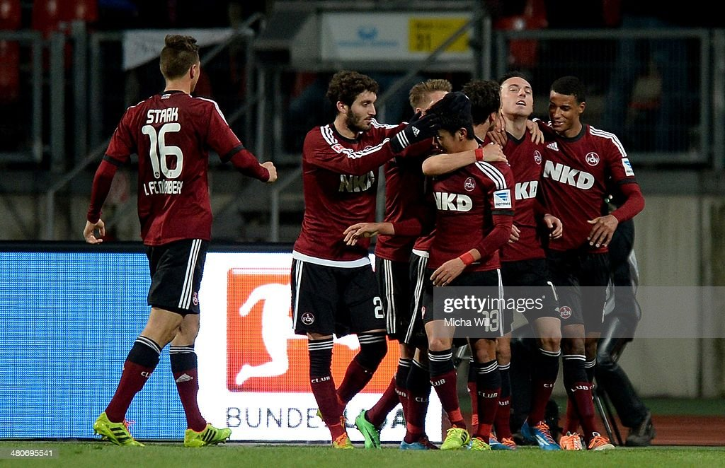 Josip Drmic of Nuernberg celebrates the opening goal with team mates during the Bundesliga match between 1 FC Nuernberg and VfB Stuttgart at Grundig...