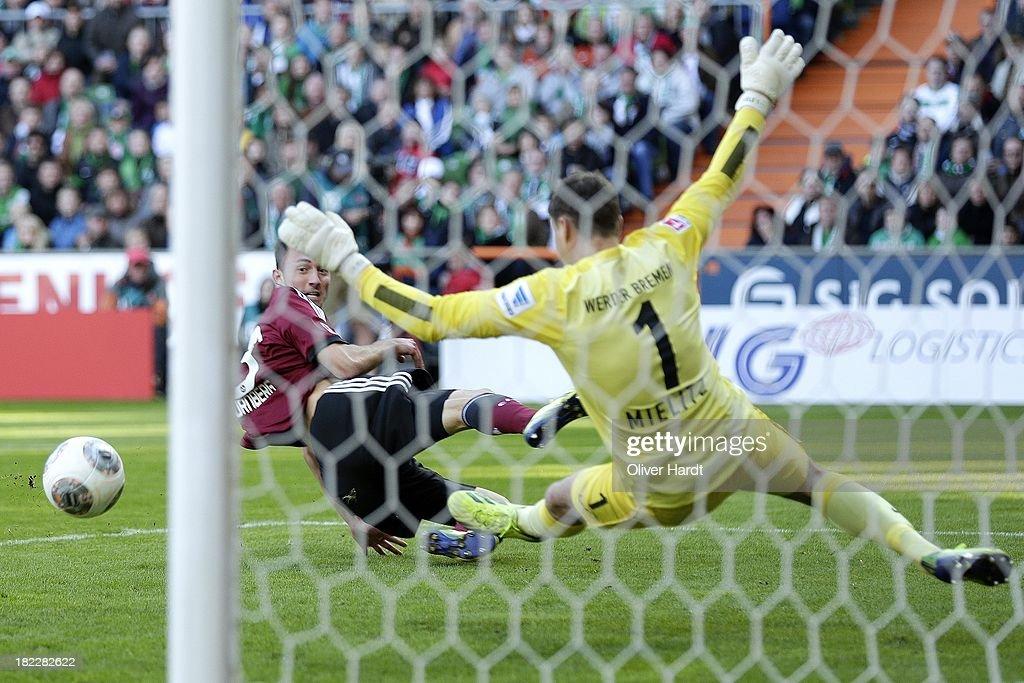 Josip Drmic (L) of Nuernberg shot the first goal during the First Bundesliga match between SV Werder Bremen and 1.FC Nuernberg at Weserstadion on September 29, 2013 in Bremen, Germany.