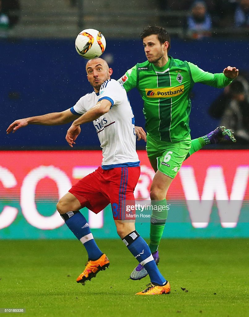Josip Drmic of SV Hamburg and Havard Nordtveit of Borussia Moenchengladbach watch the ball during the Bundesliga match between Hamburger SV and Borussia Moenchengladbach at Volksparkstadion on February 14, 2016 in Hamburg, Germany.