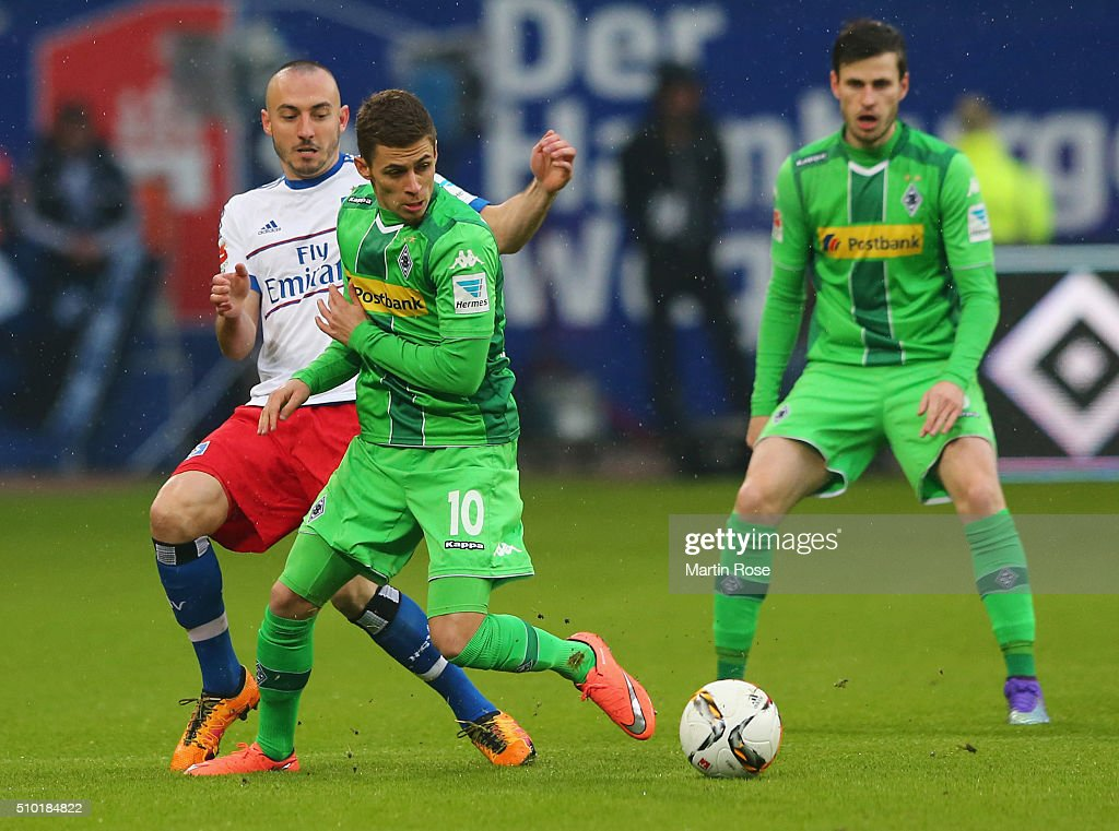 Josip Drmic of SV Hamburg and <a gi-track='captionPersonalityLinkClicked' href=/galleries/search?phrase=Thorgan+Hazard&family=editorial&specificpeople=5529022 ng-click='$event.stopPropagation()'>Thorgan Hazard</a> of Borussia Moenchengladbach battle for the ball during the Bundesliga match between Hamburger SV and Borussia Moenchengladbach at Volksparkstadion on February 14, 2016 in Hamburg, Germany.