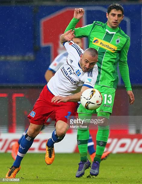 Josip Drmic of SV Hamburg evades Lars Stindl of Borussia Moenchengladbach during the Bundesliga match between Hamburger SV and Borussia...