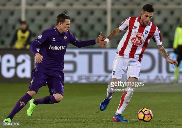 Josip Ilicic of ACF Fiorentina and Cristiano Biraghi of Pescara Calcio in action during the Serie A match between Pescara Calcio and ACF Fiorentina...