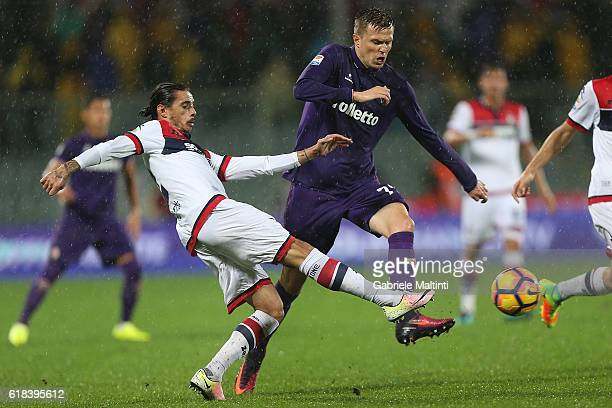 Josip Ilicic of ACF Fiorentina battles for the ball with Adrian Stoian of FC Crotone during the Serie A match between ACF Fiorentina and FC Crotone...