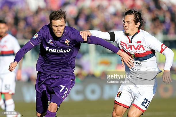 Josip Ilicic of ACF Fiorentina battles for the ball with Lucas Orban of Genoa CFC during the Serie A match between ACF Fiorentina and Genoa CFC at...