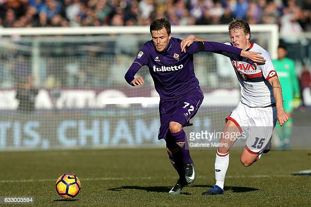 Josip Ilicic of ACF Fiorentina battles for the ball with Oscar Hiljemark of Genoa CFC during the Serie A match between ACF Fiorentina and Genoa CFC...