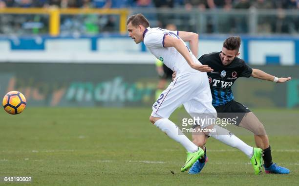 Josip Ilicic of ACF Fiorentina competes for the ball with Marco D Alessandro of Atalanta BC during the Serie A match between Atalanta BC and ACF...